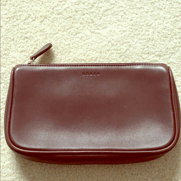 Coach Handbags - COACH leather makeup bag in chocolate brown